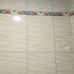 В ванной комнате кафельная